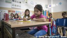 A refugee from Afghanistan in a classroom