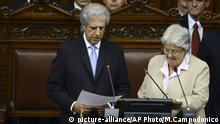 Tabare Vazquez, left, takes the presidential oath during his swearing-in ceremony, lead by Senator Lucia Topolansky, wife of outgoing President Jose Mujica, inside Congress in Montevideo, Uruguay, Sunday, March 1, 2015. (AP Photo/Matilde Campodonico) |
