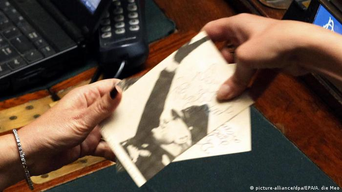 Alessandra Mussolini, the grand-daughter of the late dictator Benito Mussolini, has signed photographs of her grandfather and handed them out to neo-fascist supporters