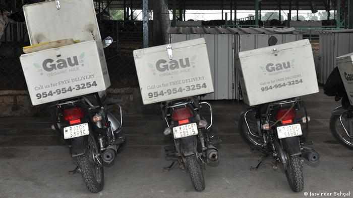 Three Motorbikes with transport boxes