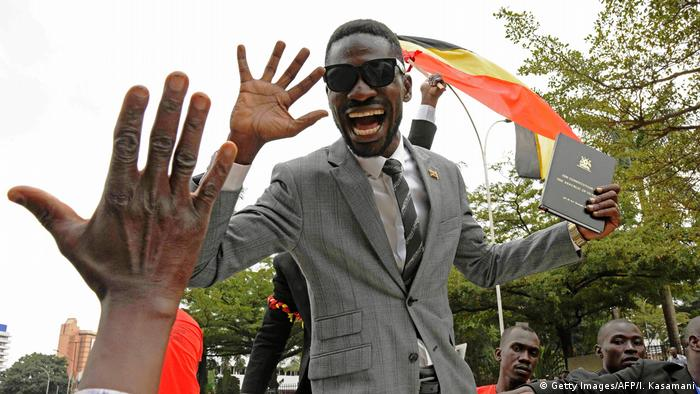 Ugandan politician Robert Kyagulanyi Ssentamu aka Bobi Wine greets supporters (Getty Images/AFP/I. Kasamani)