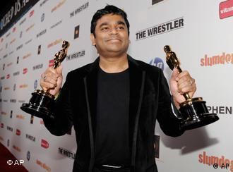 Indian composer AR Rahman holds his two Oscars