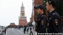 Interior Ministry officers patrol the city centre, with Red Square and the Kremlin wall seen in the background, in Moscow, Russia September 13, 2017. REUTERS/Sergei Karpukhin