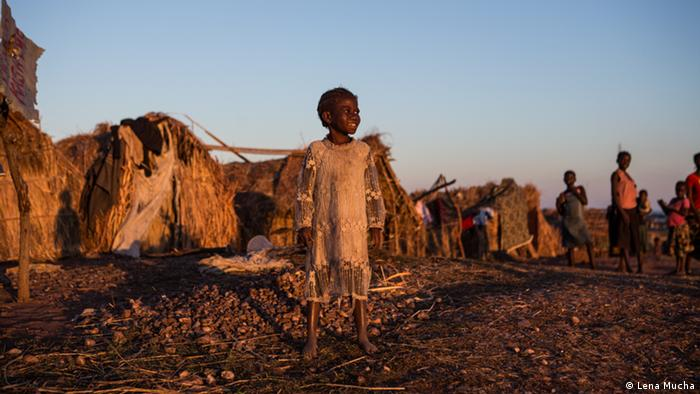 A child standing at a refugee camp in DR Congo