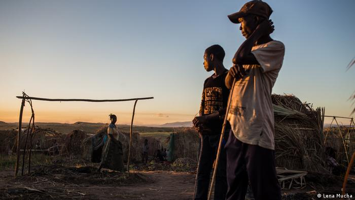 Women standing and looking afar in an IDP camp