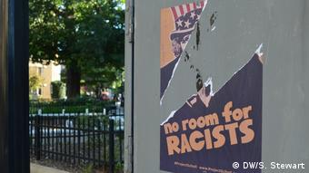 Torn-off poster Project Scholl against Trump and racism (DW/S. Stewart)