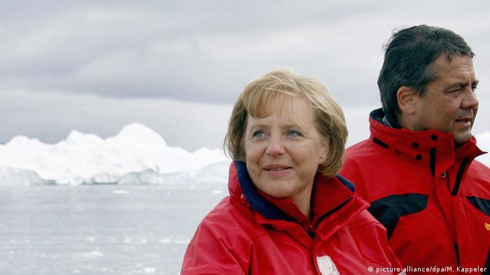 Angela Merkel and Sigmar Gabriel in front of a glacier