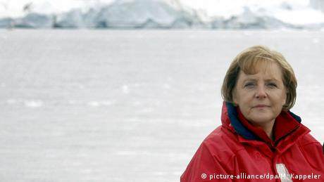 Chancellor Angela Merkel poses in front of a glacier in Greenland