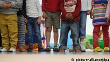 Children stand next to one another in a day care center in Germany (picture-alliance/dpa)