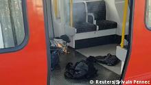 Personal belonglongs and a bucket with an item on fire inside it, are seen on the floor of an underground train carriage at Parsons Green station in West London, Britain September 15, 2017, in this image taken from social media. SYLVAIN PENNEC/via REUTERS THIS IMAGE HAS BEEN SUPPLIED BY A THIRD PARTY. NO RESALES. NO ARCHIVES. MANDATORY CREDIT