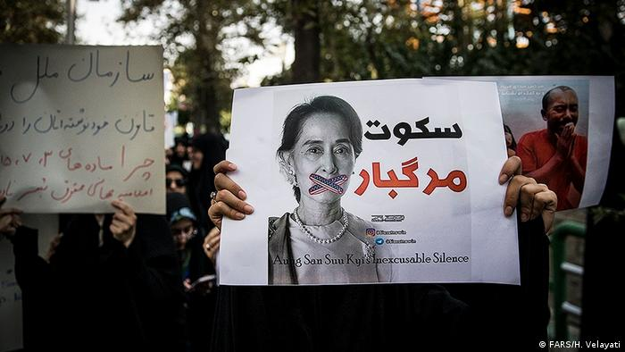 Person protests against Myanmar leader and Nobel Peace Prize winner Aung San Suu Kyi