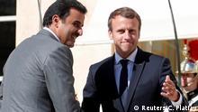 French President Emmanuel Macron (R) greets Qatar Emir Sheikh Tamim bin Hamad al-Thani at the Elysee Place in Paris, France, September 15, 2017. REUTERS/Charles Platiau
