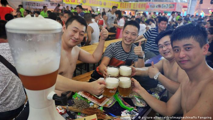 A group of men enjoying a beer at a beer festival in China