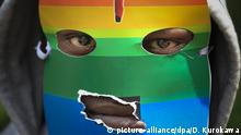 A man pictured with a rainbow coloured mask