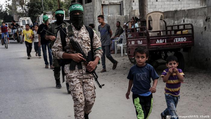 Masked youth cadets from the armed wing of the Palestinian Hamas movement march in the southern Gaza Strip city of Khan Yunis in September 2017