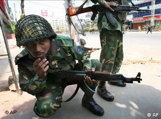 Army troops take position outside the Bangladesh Rifles HK in Dhaka