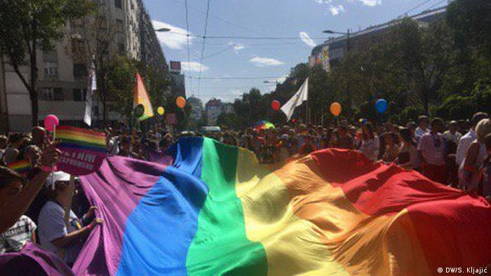 Marchers carry a huge rainbow flag through the streets of Belgrade.