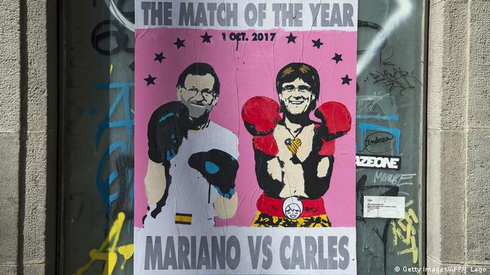 Rajoy and Puigdemont are shown wearing boxing gloves on a poster