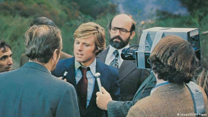 Robert Redford is interviewed while playing the role of the Democratic Party candidate, Bill McKay (Imago/ZUMA Press)