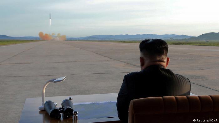 Kim Jong Un watching a missile test