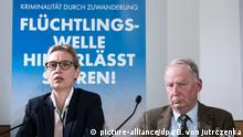 Alice Weidel an Alexander Gauland meeting reporters ? in the background a party campaign poster claiming that immigrants account for a rise in the German crime rate
