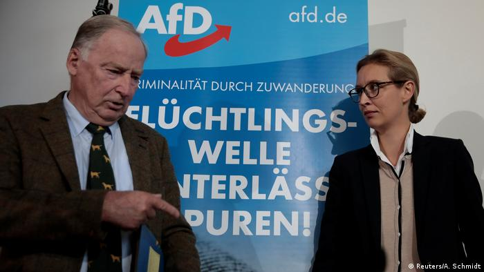 Alexander Gauland and Alice Weidel speak with journalists at a press conference in Berlin.