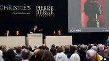 A bronze head of Janus, (circle of Francesco Primatticcio (1504-1570)), is being auctioned Wednesday, Feb. 25, 2009 at the Grand Palais in Paris. An auction of artworks and treasures collected by the late designer Yves Saint Laurent and his partner has already brought in more than €300 million ($382 million) and broken several world records _ and it's not over yet. The exceptional, three-day auction at Christie's in Paris is to finish on Wednesday night in a finale that includes two disputed bronze fountainheads looted from a palace outside Beijing in 1860. (AP Photo/Jacques Brinon)