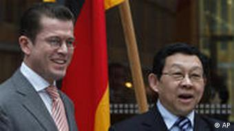 Karl-Theodor zu Guttenberg, left, and Chen Deming