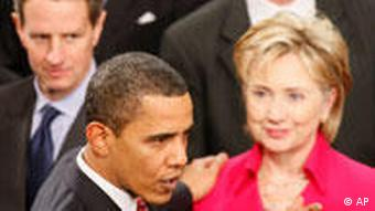 US President Barack Obama, center, and Hillary Clinton, right