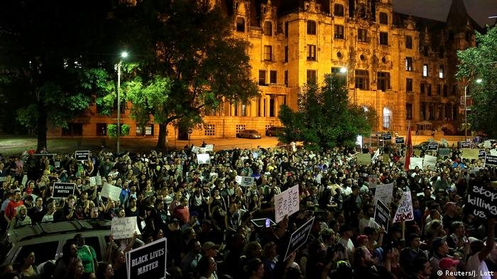 Protesters gather at night time in St. Louis