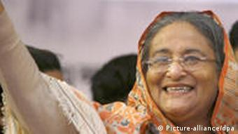 Bangladesh Prime Minister Sheikh Hasina waves to crowds