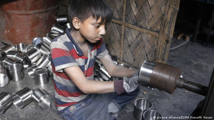A child working with machinery in Bangladesh