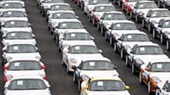 A yard full of Porsche automobiles awaiting export