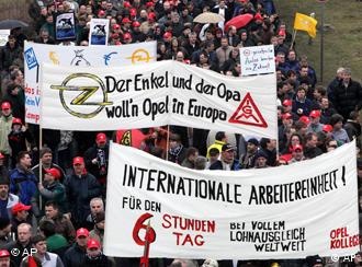An estimate 15,000 employees of German car maker Opel carrying placards and banners demonstrate for the company's survival at the Opel headquarters in Ruesselsheim near Frankfurt, central Germany