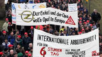 Workers demonstrate in front of the Opel plant in Ruesselsheim