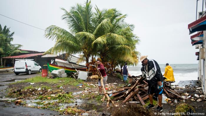 People clear debris in Saint-Pierre, on the French Caribbean island of Martinique (Getty Images/AFP/L. Chamoiseau)