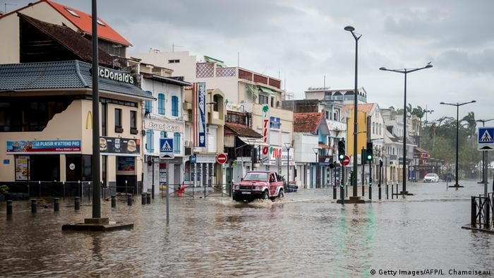 A motorist drives on the flooded waterfront in Fort-de-France, on the French Caribbean island of Martinique | Martinique