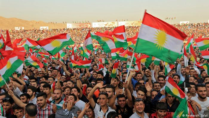 Kurdish people attend a rally to show their support for the upcoming September 25th independence referendum in Duhuk, Iraq (Reuters/A. Jalal)
