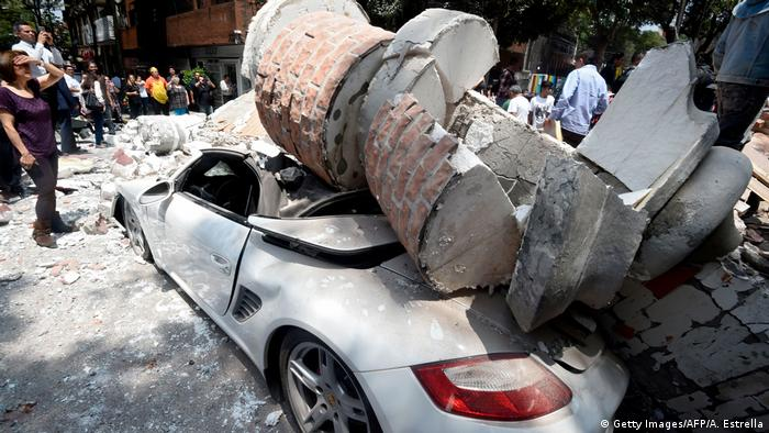Picture of a car crashed by debris from a damaged building after a quake rattled Mexico City (Getty Images/AFP/A. Estrella)
