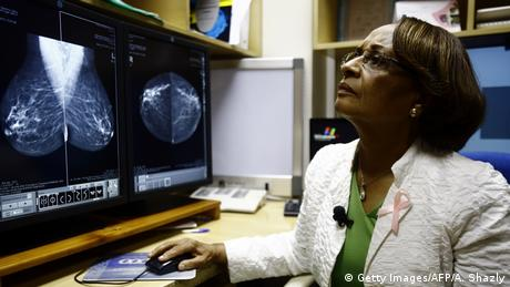 Sudanese radiologist Dr Hania Fad looks at digital images of a breast scan