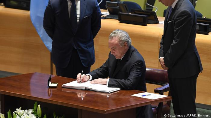 Brazilian President Michel Temer signs the nuclear weapons ban