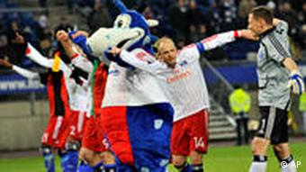 Hamburg cheers toward fans after the UEFA Cup round of 32 first leg soccer match with NEC Nijmegen