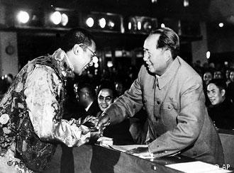 At the first National People's Congress in Beijing, China, on October 13, 1954, the Tibetan spiritual leader, the 14th Dalai Lama, left, shakes hands with Mao Tse-Tung; shortly after Mao's selection as chairman of the People's Republic of China. The Dalai Lama was quoted by Beijing radio as thanking the Communist leaders of China for reconstruction work in Tibet, which was invaded and occupied by Communist Chinese troops in 1950. (AP Photo)