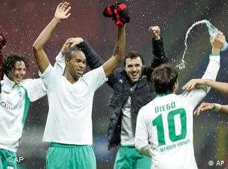 Bremen players Claudio Pizarro, left, Diego, right, and Naldo