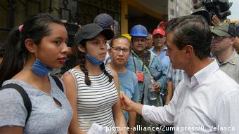 President Pena speaks with helpers in Mexico City after an earthquake struck on Tuesday.