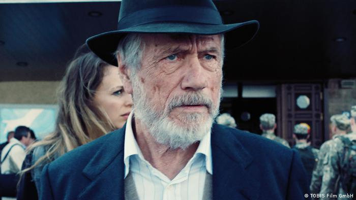 Jürgen Prochnow wearing a hat and beard in a close-up in The Final Journey.