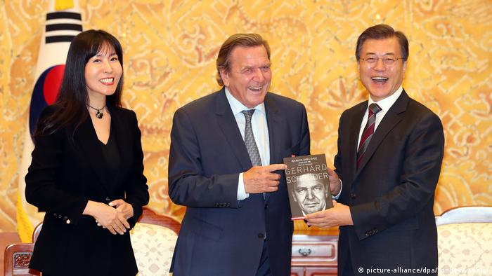 Gerhard Schröder and Kim So Yeon at the presentation of his book in South Korea