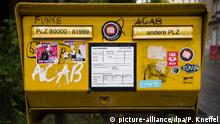 A yellow German mailbox (picture-alliance/dpa/P. Kneffel)