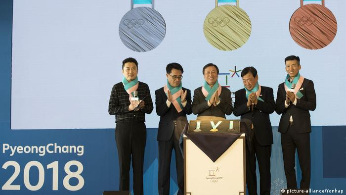South Korea sports minister Do Jong-hwan (C) at a ceremony in Seoul in September unveiling the design of medals to be awarded at the Games