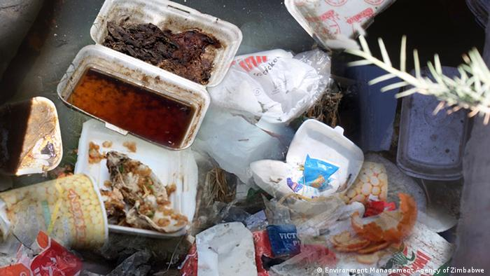 Street littered with styrofoam and other containers in Zimbabwe